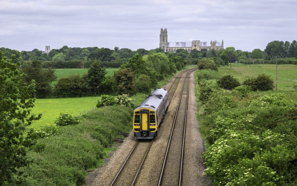 Railway train in rural landscape with minster, Beverley, Yorkshire, UK.