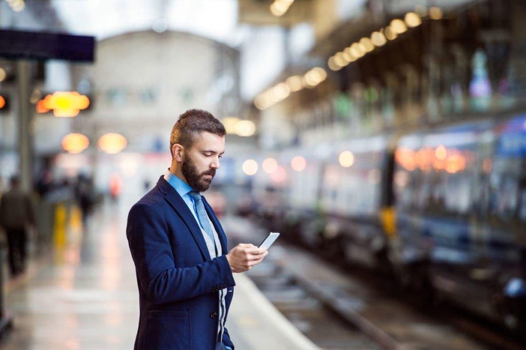 Man on phone at railway station