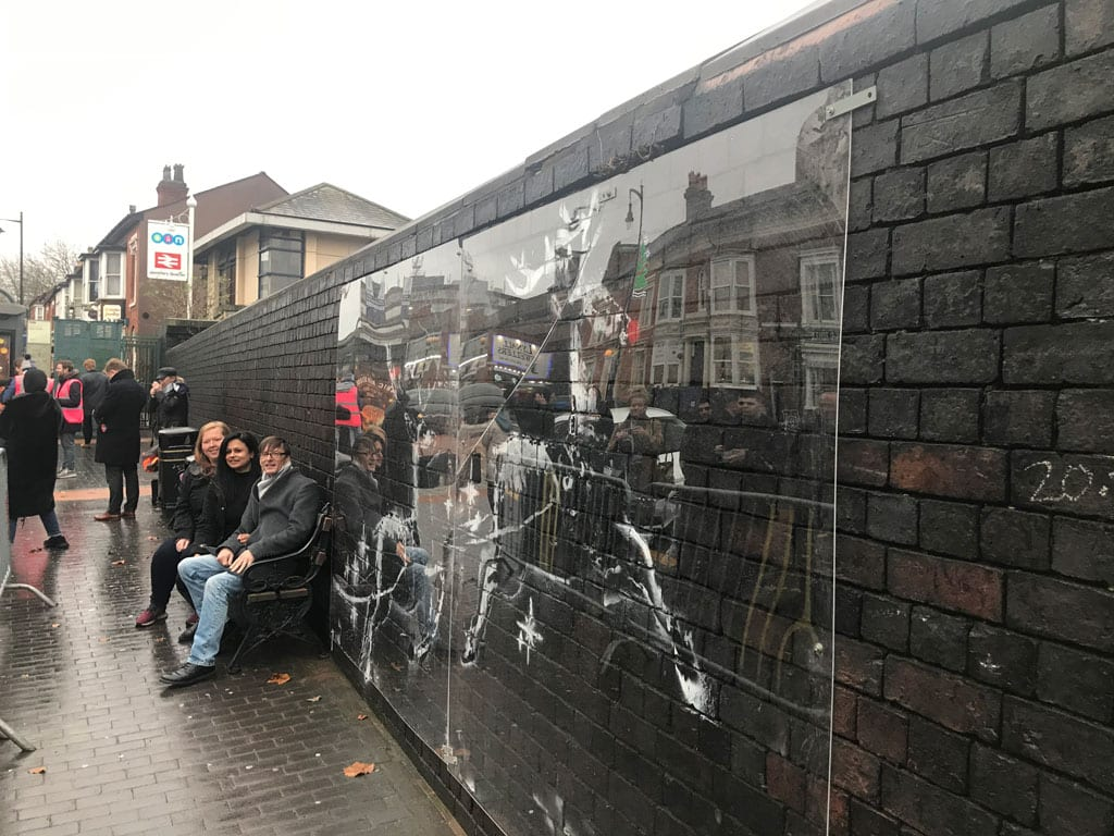 Network Rail has put a protective screen over the latest art work by world-famous street artist Banksy.