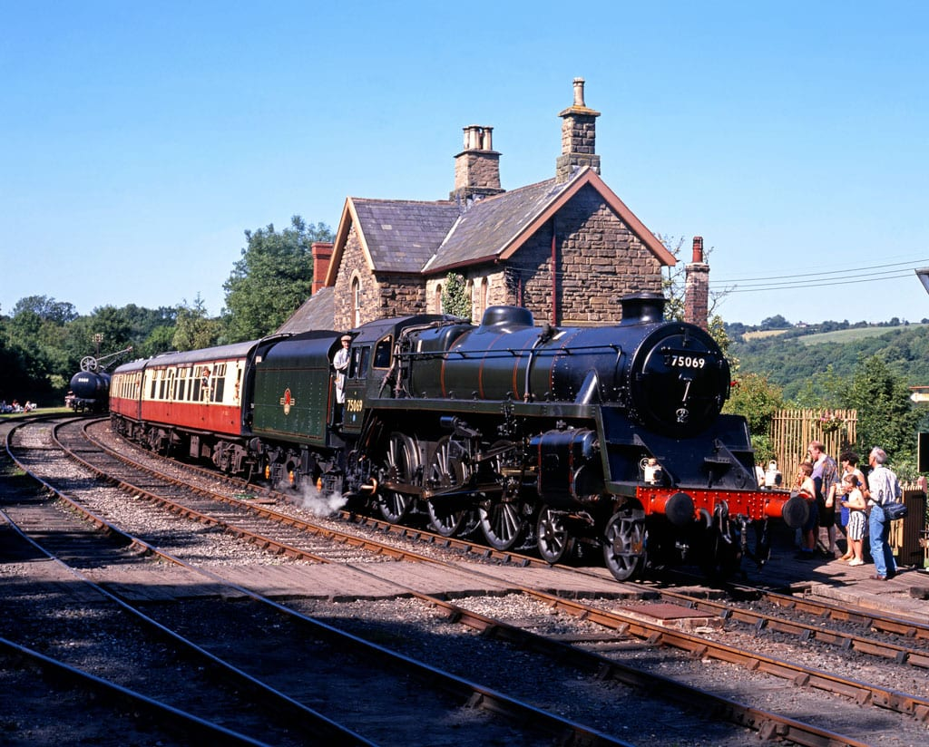 British Railways Standard Class 4 4-6-0 leaving Highley station on the Severn Valley Railway, Highley, Shropshire.