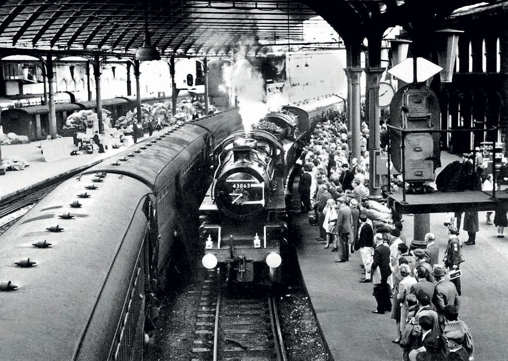 LMS Ivatt 4MT 2-6-0s Nos. 43063 and 43000 bring the stock for 'The Wansbeck Piper' into Platform 9 Newcastle Central station on October 2, 1966.