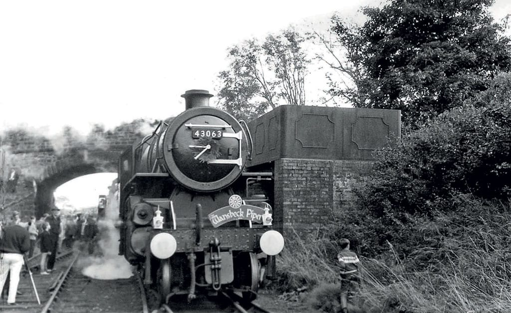 'The Wansbeck Piper' stops at Scotsgap for the two locomotives to take water.