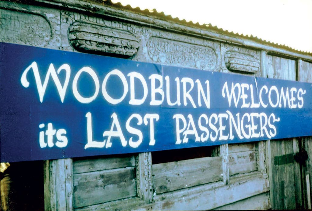 The banner fixed onto the old NER coach on Woodburn station platform.