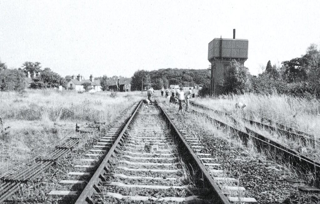 Clearing weeds from the track in 1959. Photo: Bluebell Railway Archive